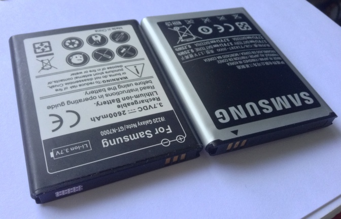 Bloated Battery from Samsung, an original battery that has given up its life in less than 18 months. The left battery is a third party battery